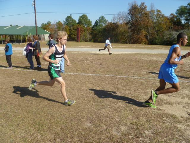 Sophomore runs fast during the first mile of the three mile long race