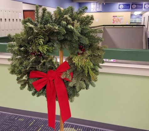 A beautiful sample wreath hangs on display at Brashier Middle College. (Grace Daniel)