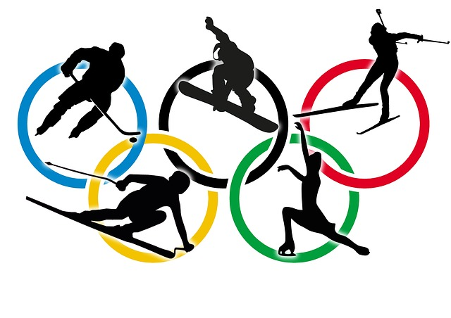 The+Olympic+rings+represent+the+five+parts+of+the+worlds+that+come+together+to+participate+in+the+Olympics%3A+the+Americas%2C+Asia%2C+Australia%2C+Europe%2C+and+Africa.+Over+the+rings+are+some+of+the+winter+sports+featured+at+the+games+%28Photo+courtesy+Stux+via+Pixabay.com%29.