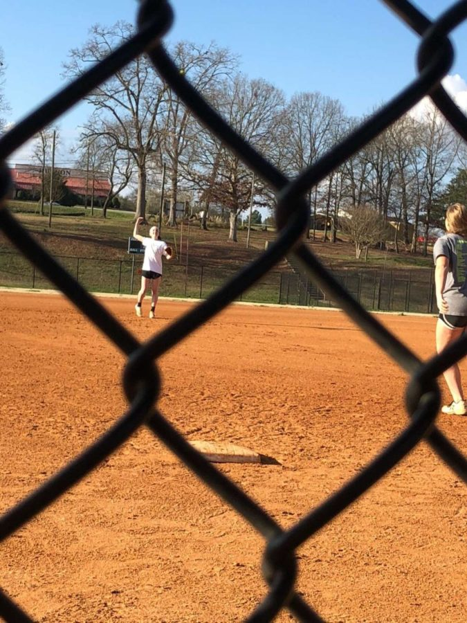 Kelsey Brown throws a pop fly for Cassidy Dickinson to catch during practice. (Photo Courtesy of Gracie Beddingfield)