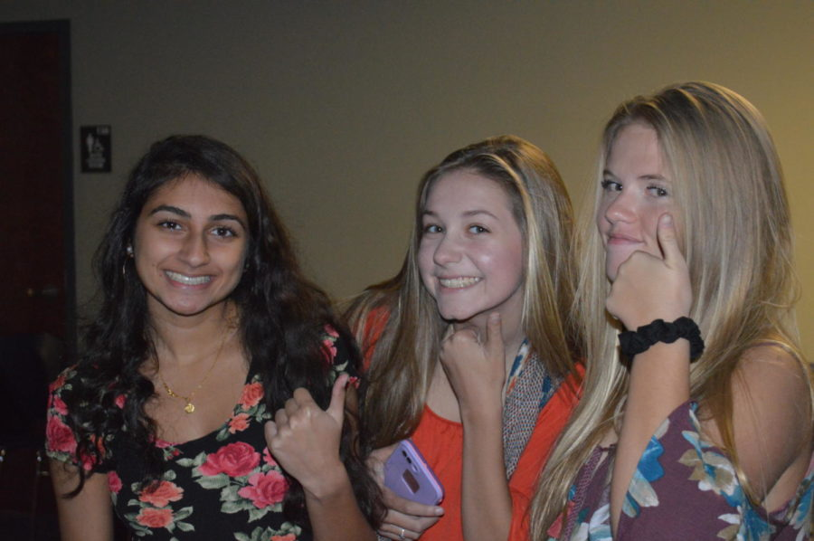 Juniors Devki Bhatt, Megan Weatherald, and Kaitlyn Runzel pose together as the night comes to a close, giving the dance a big thumbs up! (Photo courtesy of Mallory Smith)