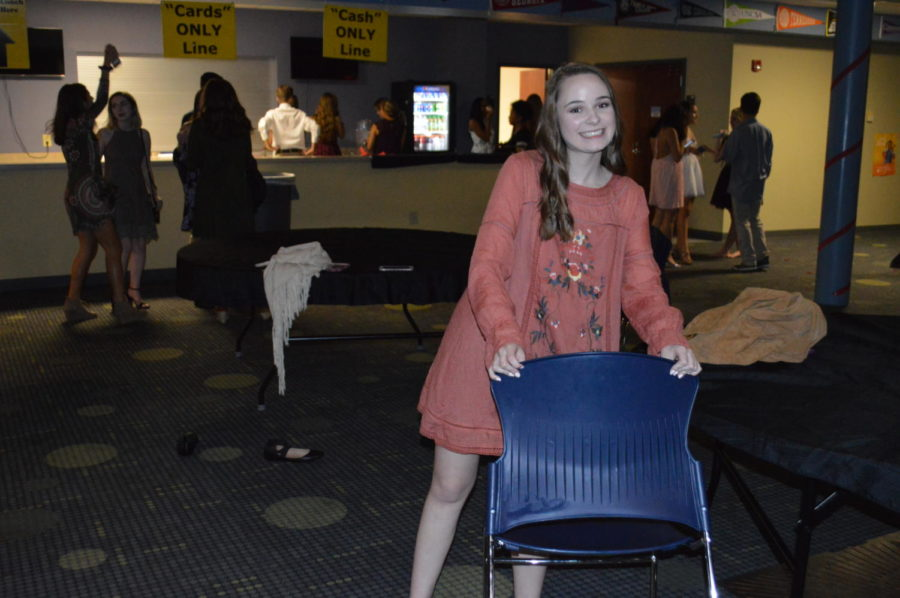 """After the dance, student forum members like junior Savannah Acord stayed behind to help clean up all the decorations. """"There is a lot of work that goes on behind the scenes, but the planning is worth the fun,"""" said Acord (Photo courtesy of Mallory Smith)."""