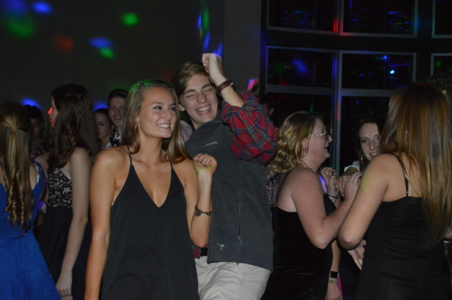 """With the dance in full swing, junior Andrew Frazier and guest Sully Mitchell were excited to hear some of their favorite songs. """"I thought the dance was fun and entertaining! My favorite part was definitely dancing with my friends,"""" said junior Kelsey Brown, back right (Photo courtesy of Mallory Smith)."""