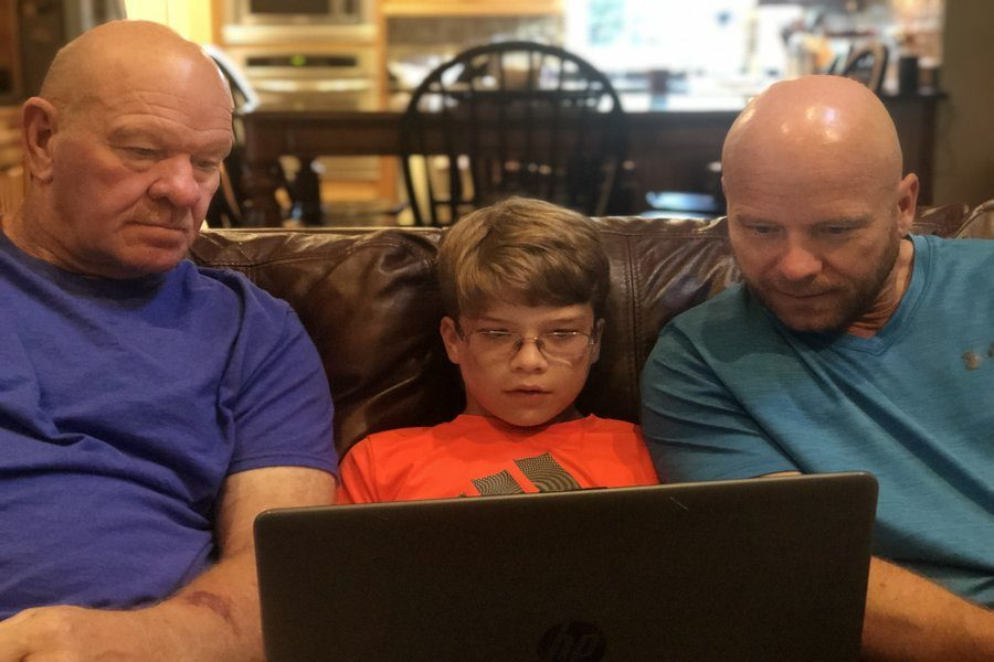 Three+generations+of+the+Ludwig+family+sit+down+to+watch+a+replay+of+a+football+game+on+their+laptop.+Left%2C+Baby+Boomer+Larry+Ludwig%3B+middle%2C+Gen+Z-er+Luke+Ludwig%3B+Right%2C+Gen+X-er+Jim+Ludwig+%28Photo+courtesy+of+Peyton+Ludwig%29.