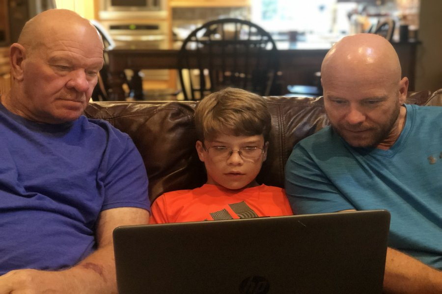 Three generations of the Ludwig family sit down to watch a replay of a football game on their laptop. Left, Baby Boomer Larry Ludwig; middle, Gen Z-er Luke Ludwig; Right, Gen X-er Jim Ludwig (Photo courtesy of Peyton Ludwig).