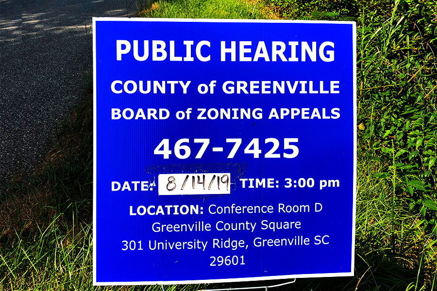 Signs like the one pictured above are often the only warning residents get before property is sold and rezoned (Photo courtesy of Mattie McConnell, Photo Art courtesy of Alexander Gray)