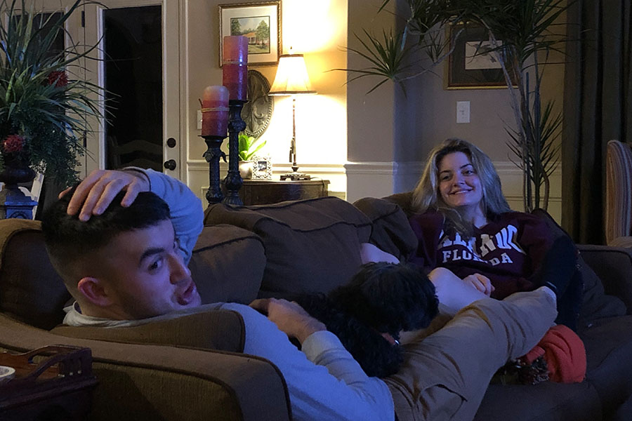 Tripp and Sarah Neal spend time together with their beloved dog and best boy, Buster (Photo courtesy of Pate Neal).