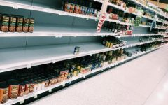 Most grocery stores are almost out of everything; for instance, this store has many holes to fill in their can aisle (Photo courtesy of Clara Cianfarano).