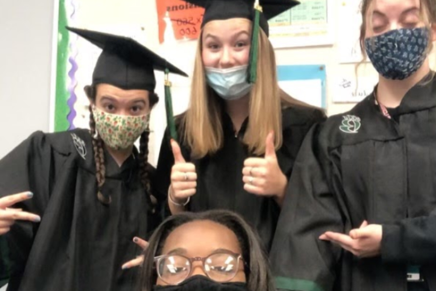 Some of our favorite seniors are breaking in their caps and gowns (Photo Courtesy of Alaina Haylock).